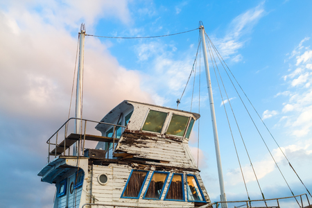 superstructure: Close-up of a superstructure and the captains cabin of the old weathered ship on a blue sky background. Stock Photo