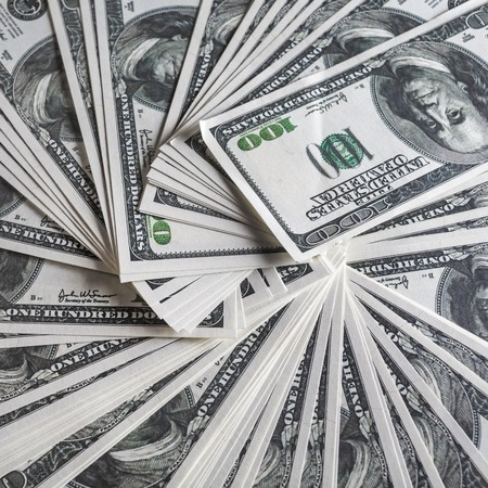 fake money: Close-up of a lot of one hundred dollar bills. Much money. Many hundred dollar banknotes. Fake money. Stock Photo