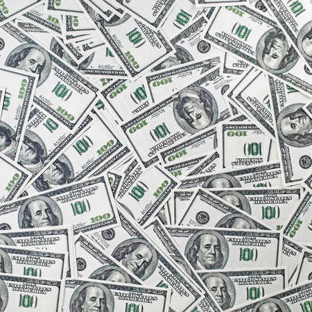 fake money: Background from a variety of hundred-dollar bills. Many money. Dollars background. Fake money. Stock Photo