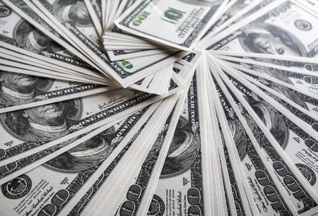 fake money: Many one hundred dollar bills. Much money. A lot of money. Fake money. Selective focus.