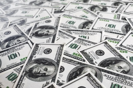fake money: Fake money background. Business concept. Pile of one hundred dollar bills. Shallow depth of field. Selective focus. Stock Photo