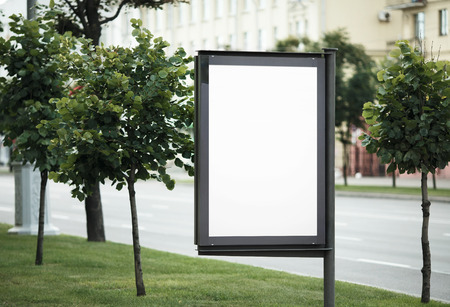 urban scene: Blank street poster. Blank billboard on the city street. Isolated with clipping path. Shallow depth of field. Selective focus.