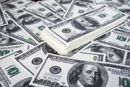 fake money: Big pile of money. Pile of one hundred dollar bills. Fake money. Money background. Business concept. Shallow depth of field. Selective focus.
