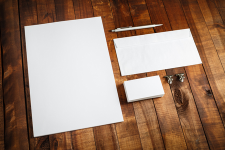 blank photo: Photo of blank stationery set on wooden background. Template for design presentations and portfolios. Letterhead, business cards, envelope and pen.