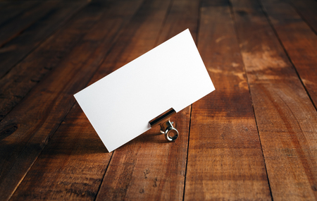 for designers: Blank business card on vintage wooden background. Photo of blank business card. Mock-up for branding identity for designers.