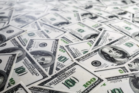 fake money: Fake money background. Business background. One hundred dollar bills. Shallow depth of field. Selective focus.
