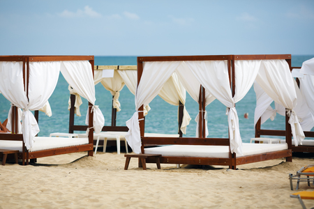 canopies: White beach canopies. Luxury beach tents at the resort for relaxation and spa treatments. Stock Photo