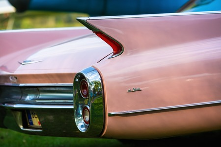 MINSK, BELARUS - MAY 07, 2016: Close-up photo of pink Cadillac de Ville. Back view of retro car. Selective focus. Editorial