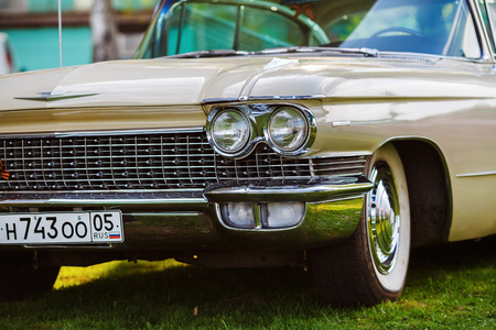 ville: MINSK, BELARUS - MAY 07, 2016: Close-up photo of beige Cadillac de Ville 1959 model year. Headlight of vintage car. Close-up detail of retro auto. Selective focus. Editorial