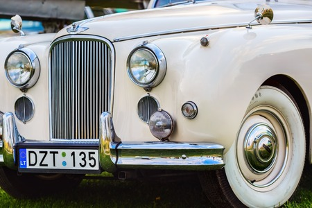 mk: MINSK, BELARUS - MAY 07, 2016: Close-up of white Jaguar Mk VIII. This classic car was produced in the years 1956-1958. Front part of an vintage retro auto. Selective focus on the cars headlight.