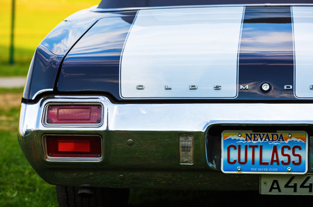 cutlass: MINSK, BELARUS - MAY 07, 2016: Oldsmobile Cutlass Supreme Convertible 1971 model year. Back view of retro classic vintage car. Selective focus.