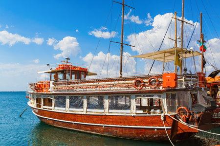 passenger ship: NESEBAR, BULGARIA, SEPTEMBER 06, 2013: Pleasure yacht in the port of the old town of Nessebar. Black Sea coast. Wooden passenger ship standing at the pier. Sunny summer day. Editorial