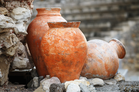 Old ancient clay vases outdoors. Still life of ceramic pots. Shallow depth of field. Selective focus.