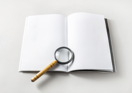 note booklet: Blank opened book and magnifier on paper background. Template for placing your design. Responsive design mockup.
