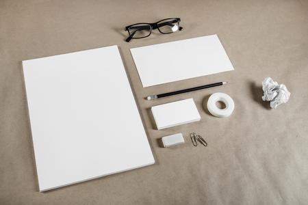 white sheet: Corporate stationery set on craft paper background. Blank branding mock-up.
