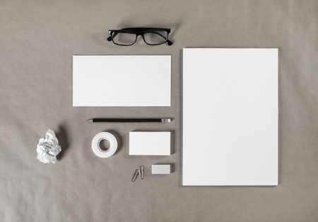 white sheet: Blank corporate stationery on craft paper background. Branding mock up for graphic designers portfolios. Top view. Stock Photo