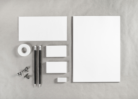 white sheet: Blank white stationery mock-up. Template for branding identity on craft paper background. For graphic designers presentations and portfolios. Top view.