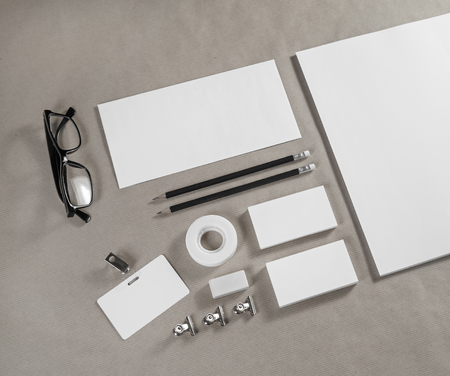 white sheet: Blank corporate stationery template on craft paper background. Branding identity mock up.