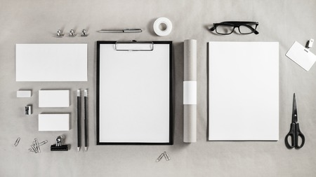 white sheet: Corporate identity template. Photo of blank stationery set on craft paper background. Mockup for branding identity. Top view. Stock Photo