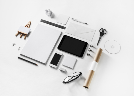 Photo of blank corporate stationery and gadgets set on white paper background. Business brand template.