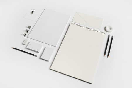 Photo of blank stationery elements on white paper background. Branding template. Mock-up for your design.