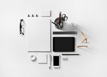 Blank corporate stationery and gadgets set on white paper background. Business brand template. Flat lay.