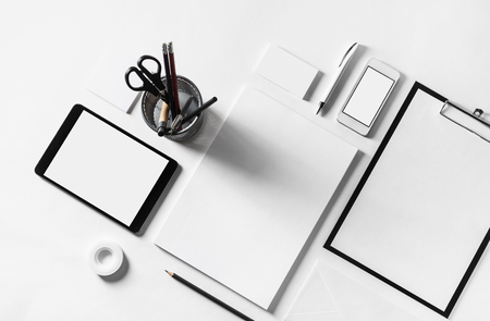 Photo of blank stationery set on paper background. Responsive design mockup. ID template. Stock Photo