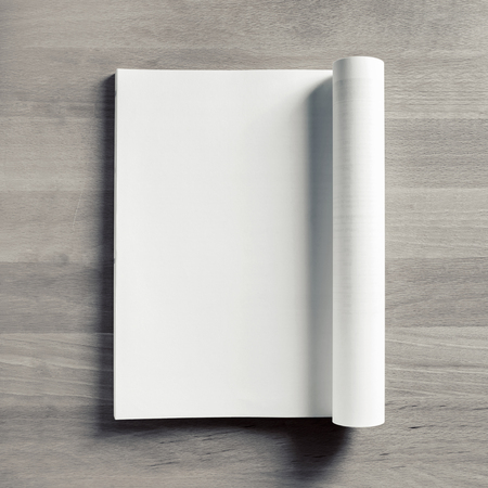 Blank opened magazine mock up. Catalog on wooden table background. Top view. Flat lay.