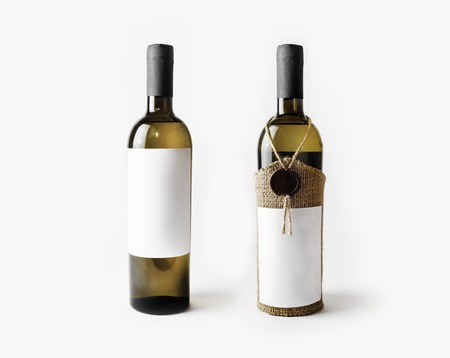 Two wine bottles with blank labels. Template for placing your design.