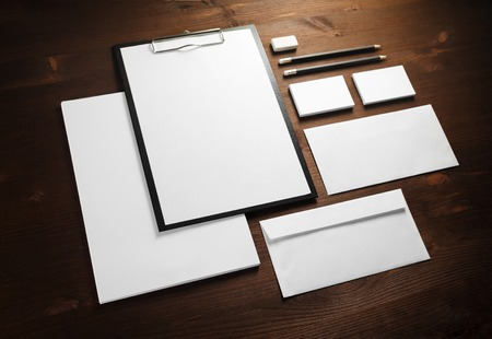 Blank corporate stationery on wooden background. Template for branding identity. 版權商用圖片