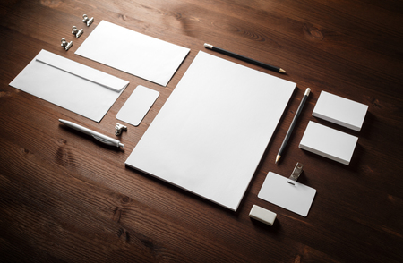Blank white stationery set. Business brand template on wooden background. 版權商用圖片
