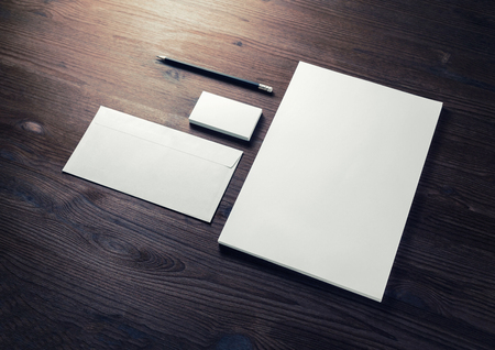 Photo of blank corporate identity. Stationery set. Branding mockup. Letterhead, business cards, envelope and pencil.