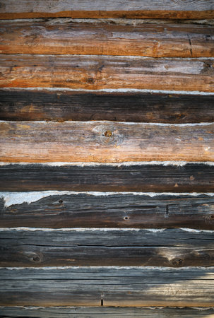 Vintage wood logs wall background. Weathered wooden texture.