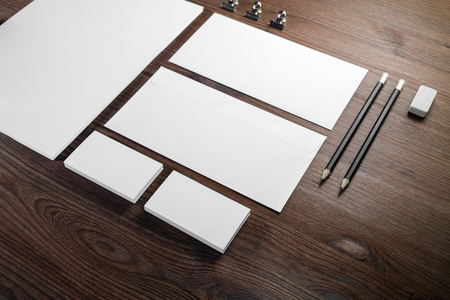 Blank corporate identity template on wood table background. Photo of blank stationery set. Mockup for design presentations and portfolios. 版權商用圖片
