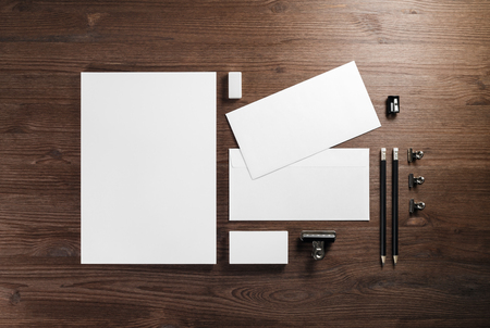 Blank corporate stationery template on wooden background. Responsive design mockup. Flat lay. 版權商用圖片