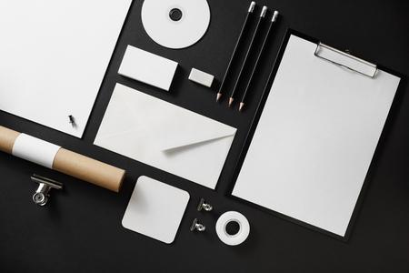 Blank corporate stationery set on black paper background. Branding mock up. Flat lay.