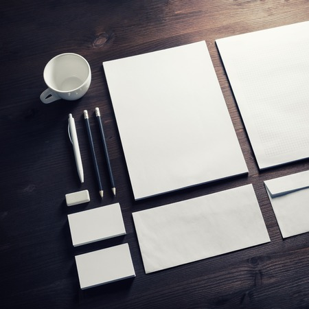 Blank corporate identity template on wooden background. Photo of blank stationery set. Mockup for design presentations and portfolios.