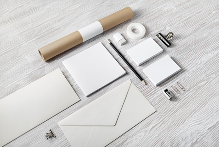 Blank corporate stationery set on light wood table background. Branding mock up. Imagens