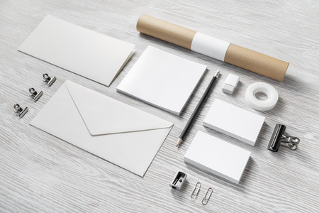 Blank corporate identity on light wooden background. Stationery template. Branding mockup.