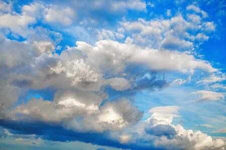 Sky with voluminous cumulus clouds. Natural background.