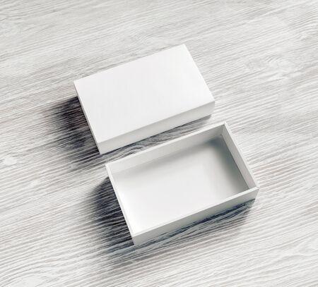 Blank paper box on light wooden background. White box mockup. Branding mockup.