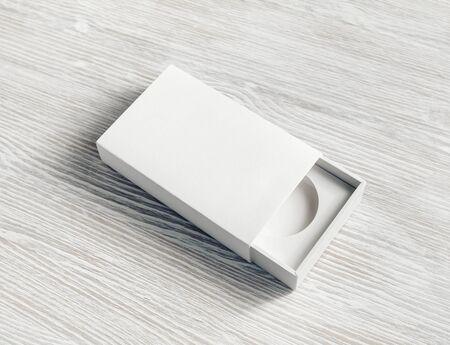 White box mock up. Blank paper box on light wooden background. Branding mockup. Flat lay. Reklamní fotografie