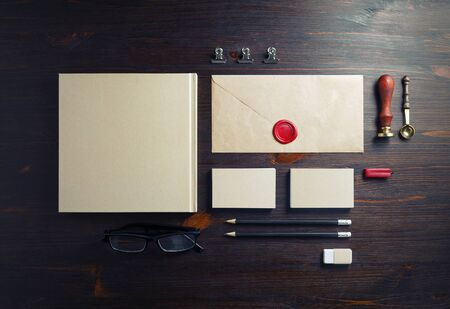 Corporate identity template. Blank corporate stationery set on wood table background. Flat lay.
