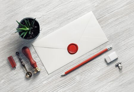Blank retro stationery and envelope on light wood table background. Flat lay.