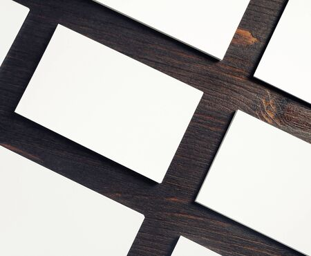 Photo of blank white business cards on wooden background. Template for design presentations and portfolios. Copy space for text. 스톡 콘텐츠