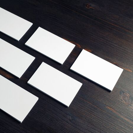 Blank white business cards on wooden background. Copy space for text.