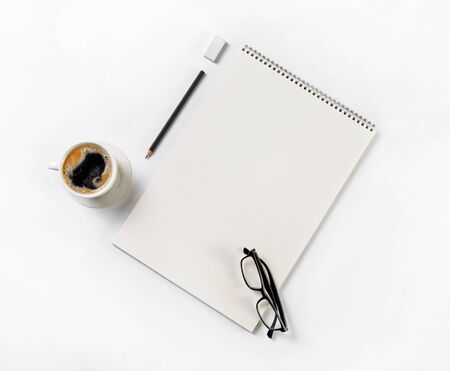 Sketchbook, glasses, coffee cup, pencil and eraser. Blank stationery template Flat lay 스톡 콘텐츠