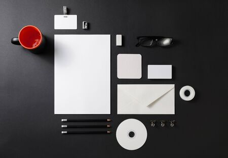 Blank corporate stationery set on black paper background. Branding mock up. Flat lay.