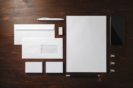 Photo of blank stationery set on wooden background. Template for branding identity. Responsive design mockup. Flat lay.
