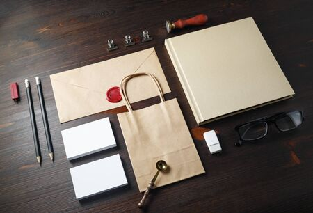 Blank stationery mock up. Blank corporate identity set on wood table background. Responsive design template.